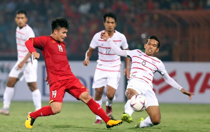 Quang Hải (áo đỏ) được cho là nhân tốnguy hiểm nhất với đối thủ của Việt Nam. Ảnh: Đức Đồng.