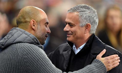Pep và Mourinho vừa là đối thủ, vừa là những người bạn cũ của nhau. Ảnh: Reuters