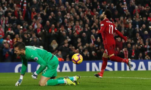 Salah ghi bàn thắng thứ 12 ở Ngoại hạng Anh mùa này. Ảnh:Reuters.
