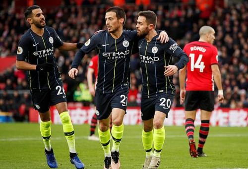 Man City vượt Tottenahm đểtiếp tục bám đuổi Liverpool. Ảnh: Reuters.