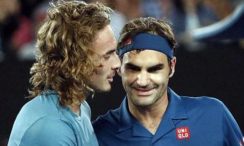 Federer (phải) lần thứ hai lỡ hẹn với tứ kết Australia Mở rộng kể từ năm 2003. Ảnh: Reuters.