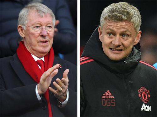 Ferguson (trái) không can thiệp quá sâu vào chuyên môn của Solskjaer như nhiều người nghĩ. Ảnh: AFP.
