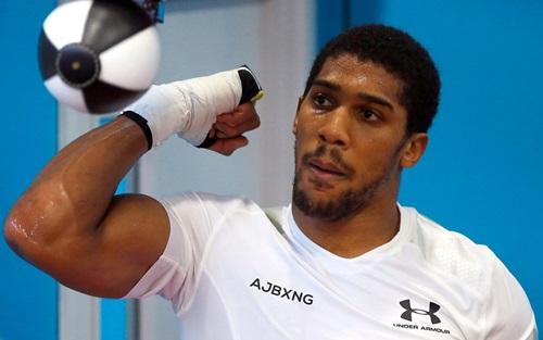 Joshua hiện giữ bốn đai vô địch WBA, WBO, IBF và IBO. Ảnh: PA.