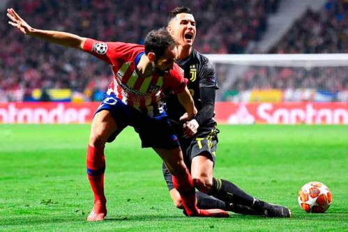 Ronaldo bất lực trước Atletico trong lần đầu tiên trở về thi đấu tại Madrid. Ảnh:AFP.