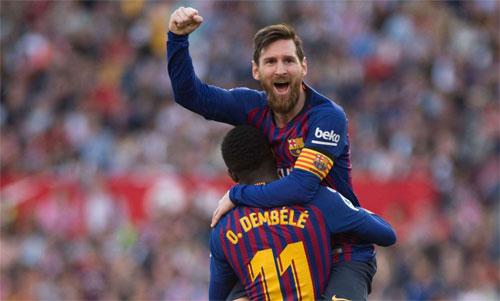 Messi tỏa sáng đúng lúc giúp Barca vượt trước Atletico 10 điểm. Ảnh: Reuters
