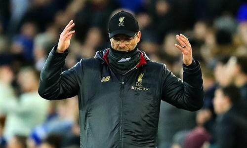 Klopp lạc quan dù Liverpool bị Man City soán ngôi đỉnh bảng. Ảnh: EPA.
