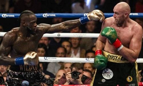 Wilder (trái) chưa thể tái đấu với Fury. Ảnh: Reuters.