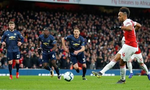 Aubameyang thực hiện thành công quả phạt đền mang về chiến thắng cho Arsenal. Ảnh: Reuters.