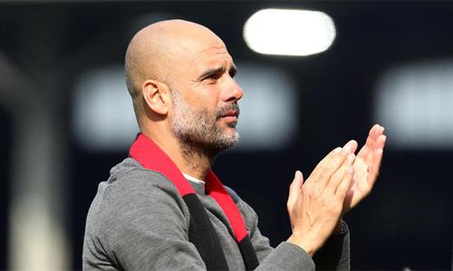 Guardiola cho rằng áp lực chiến thắng sẽ mang lại điều tích cực cho Man City. Ảnh: Reuters.