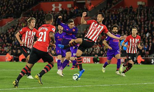 Lối chơi phòng ngự số đông của Southampton suýt nữa khiến Liverpool phải chia điểm. Ảnh:AFP.