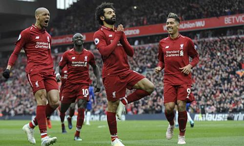 Salah chia vui bàn thắng ấn định tỷ số. Ảnh:AP.