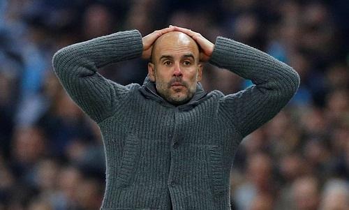 Guardiola cho rằng Man City đã bị loại theo một cách đầy đau đớn. Ảnh: Reuters.