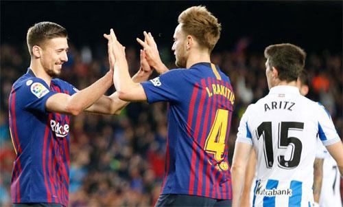 Barca có thể đăng quang trong 36 giờ tới. Ảnh: Reuters