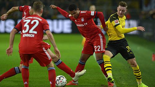 Cuộc đua giữa Bayern và Dortmund hứa hẹn gay cấn tới vòng cuối. Ảnh:AFP.