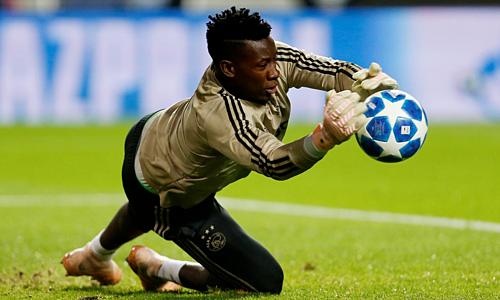 Onana mơ về mùa giải ăn ba cùng Ajax. Ảnh: Reuters.