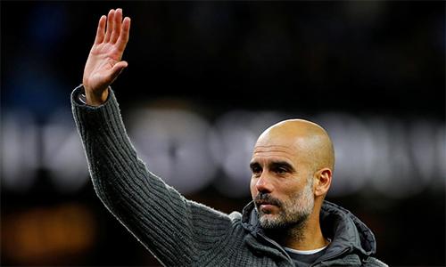 Guardiola đang rất quyết tâm cùng các học trò giành cú ăn ba mùa này. Ảnh: Reuters.