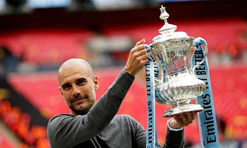 Guardiola đánh giá cao cú ăn ba quốc nội hơn Champions League. Mùa này, Man City bị Tottenham loại ở tứ kết Cup châu Âu. Ảnh: Reuters.