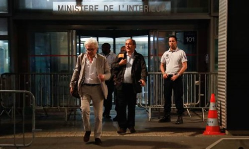 Platini rời . Ảnh: AFP.
