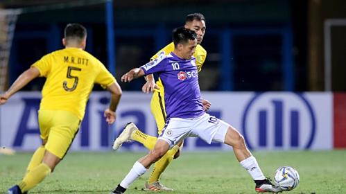 Văn Quyếtvà các đồng đội ở CLB Hà Nội đang có có hội khẳng định vị thế của bóng đá Việt Nam ở khu vực. Ảnh: AFC.