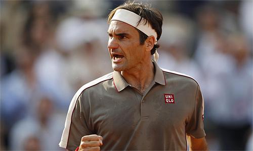 Federer có chín cú ace và đạt tỷ lệ thắng điểm bóng một là 90% ở vòng một Halle. Ảnh: Reuters.