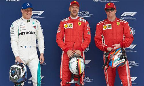 Raikkonen (phải) có vòng đua phân hạng tốt nhất từ khoảng một năm trở lại đây, nhưng vẫn chưa thể thắng được đàn em đồng đội Vettel. Ảnh: LAT Images.