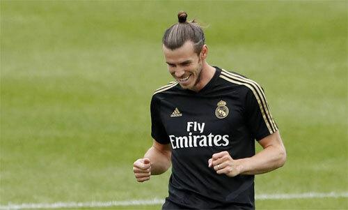 Bale sẽ có rất nhiều tiền nếu chịu đến Trung Quốc. Ảnh: Reuters