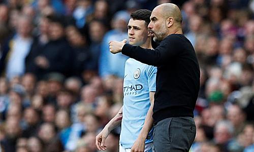 Guardiola đánh giá cao tài năng của Foden. Ảnh: AFP.