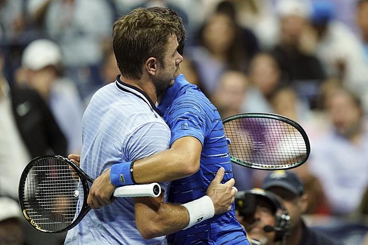 Wawrinka (trái) cho thấy anhlà khắc tinh của Djokovic tại Mỹ Mở rộng.Ảnh: AP.