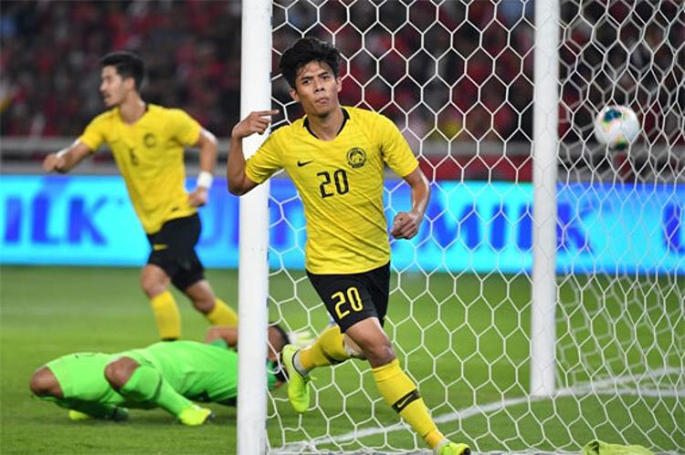 Malaysia dẫn bàn trước đối thủ khó chơi. Ảnh: Reuters