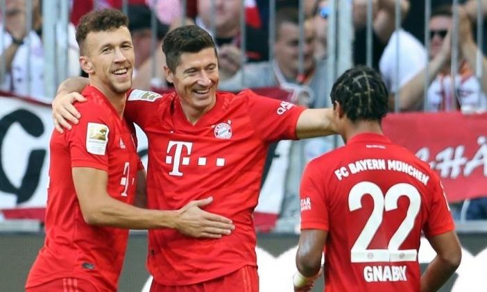 Perisic (trái) góp một bàn trong chiến thắng của Bayern. Ảnh: Reuters.