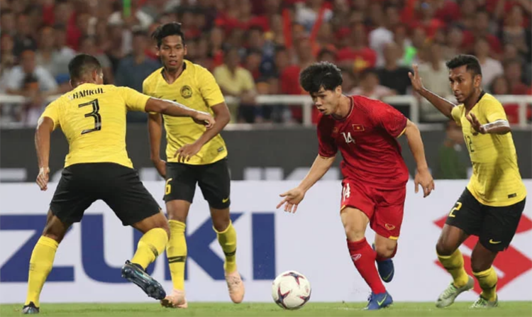 Việt Nam đánh bại Malaysia tại chung kết AFF Cup 2018. Ảnh: Đức Đồng