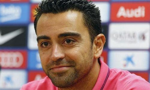 Xavi có thể huấn luyện Barca trong tương lai gần. Ảnh: Reuters