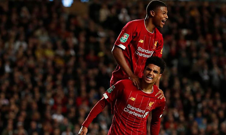 Hoever (dưới) ghi bàn trong lần đầu đá chính cho Liverpool. Ảnh: Reuters.