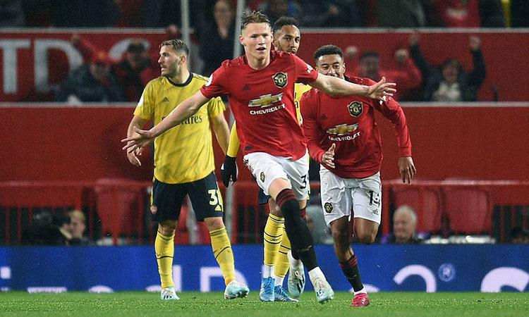 McTominay mừng bàn mở tỷ số cho Man Utd. Ảnh: REX.