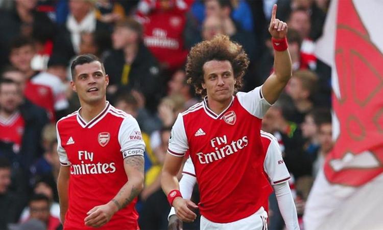 Arsenal đang có tín hiệu khởi sắc mùa này, khi xếp thứ ba sau tám vòng. Ảnh: Reuters.