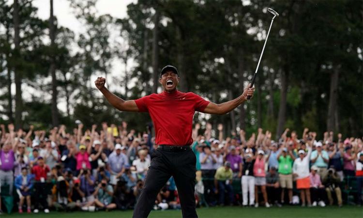 Chiến thắng ở The Masters 2019 được xem là một cảm hứng khác để Tiger Woods chắp bút viết hồi ký về bản thân và sự nghiệp. Ảnh: AP.