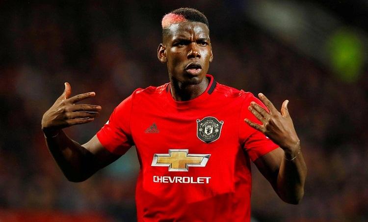 Pogba bị đồn sẽ rời Man Utd để đến Real. Ảnh: Reuters.