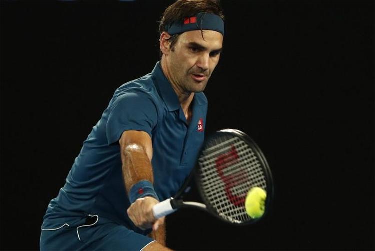 Federer hướng đến chiến thắng thứ 1232 trong trận thứ 1500 tròn trong sự nghiệp quần vợt nhà nghề. Ảnh: Reuters.