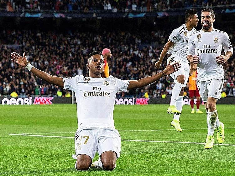 Rodrygo mừng những bàn thắng đầu tiên tại Champions League. Ảnh: EPA.