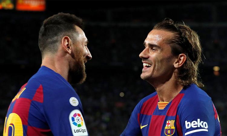 Griezmann chưa biết cách chơi như Messi hay Suarez. Ảnh: Reuters