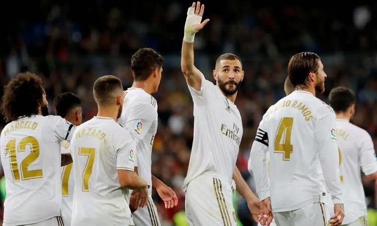 Hiệu suất đóng góp bàn thắng của Benzema cao hơn Ronaldo. Ảnh: Reuters.