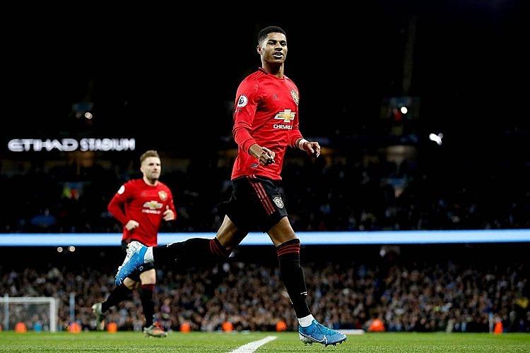 Rashford mừng bàn thắng thứ 13 sau 21 trận từ đầu mùa. Ảnh: Reuters.