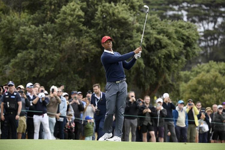 Woods khởi đầu ấn tượng tại Presidents Cup 2019. Ảnh: AP.