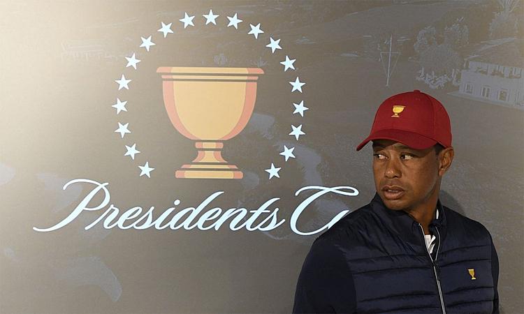 Woods lần đầu dự Presidents Cup trong cả hai vai trò, đội trưởng và golfer. Ảnh: AP.