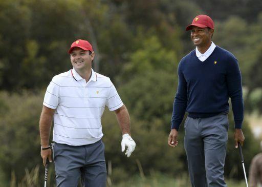 Sự ủng hộ và tin tưởng của Woods là động lực quan trọng giúp Reed chơi tốt, góp phần làm nên thắng lợi ngược dòng cho tuyển Mỹ tại Presidents Cup 2019. Ảnh: AP.