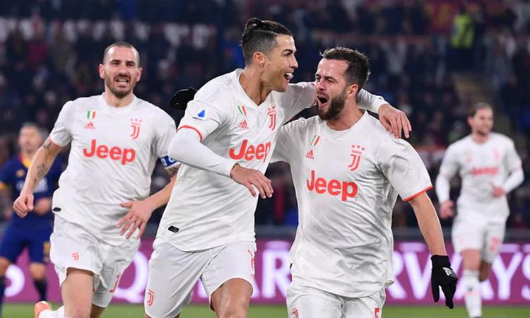 Quả phạt đền thành công trước Roma là bàn thứ 14 của Ronaldo tại Serie A mùa này, và là bàn thứ chín của anh chỉ trong sáu trận gần nhất. Ảnh: Lapresse.