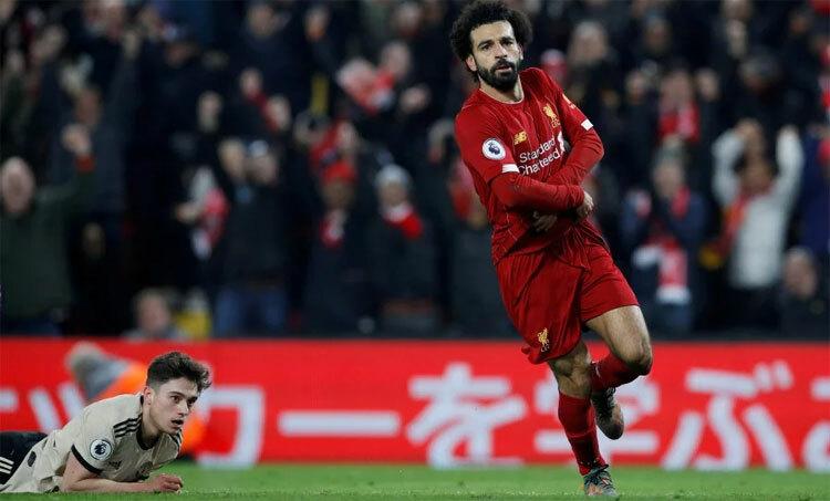 Salah và đồng đội đang hướng đến chức vô địch và mùa giải bất bại. Ảnh: Reuters