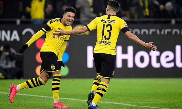 Sancho (trái) và Guerreirolà người ghi bàn trước khi Haaland vào sân. Ảnh: AFP.