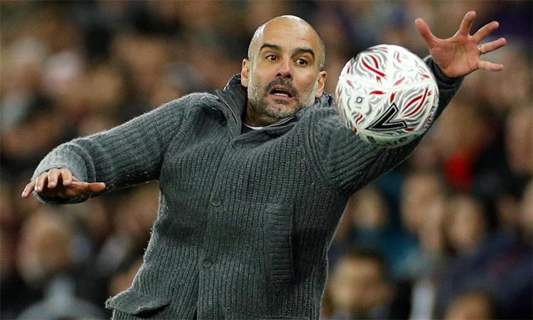 Guardiola cho rằng việc giảm các trận đá lại sẽ giúp các đội bóng đỡ bị quá tải và tăng sức hấp dẫn cho Cup FA. Ảnh: Reuters.