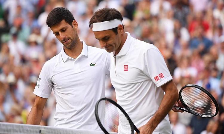 Federer đang lép vé Djokovic về thành tích đối đầu chung cuộc, lẫn đối đầu ở Australia Mở rộng. Ảnh: Reuters.